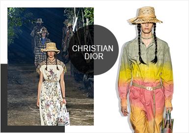 Christian Dior 2020 春夏秀場宛如幽謐的森林,用164棵洋菩提樹建造了花園,一方面表達了對近年日益嚴重的氣候變化問題的思考,另一方面關聯一位重要的繆斯Miss Dior — 品牌創始人 Christian Dior 的妹妹 Catherine Dior。這場人類與植物平衡關系的嚴肅探討靜止在了這座充滿了各種綠植的奇妙花園中的一個月夜。模特們腳踩泥土地,借著葉片間稀松的月光從濃郁的林道中緩緩出現。這座包羅萬象的花園象征著瑪麗亞女士對于人類與地球平衡共處的烏托邦的設想,也孕育著像植物一樣生生不息而且強大不屈的靈感與信念。